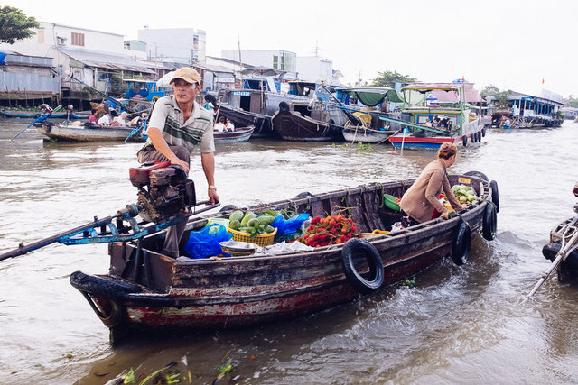 One of smaller boats got closer to try to sell some of their fruit