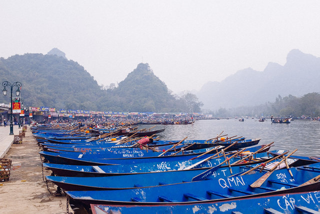 Boats parked at the foot of the mountain